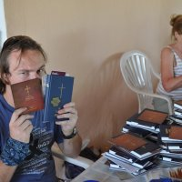 Jono busy packing Bible packs before the Bible distribution